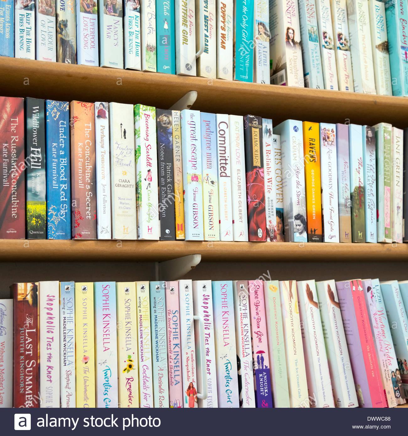 Paperbacks in rows on a bookshelf, UK. - Stock Image