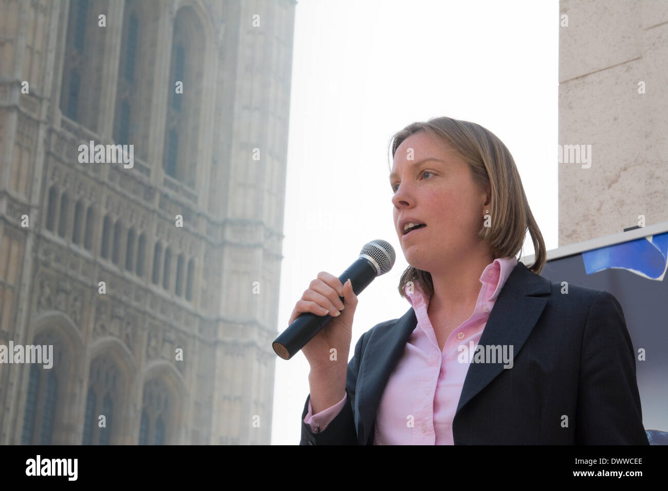 London, UK. 13th Mar, 2014. Tory MP Tracy Crouch speaks against the badger cull as protesters gather outside Westminster, while a parliamentary debate on the controversial badger cull takes place inside the house of commons. Badgers have been linked to the spread of bovine tuberculosis in cattle and experimental culls of badgers were carried out in 2013 in an attempt to stop the spread of the disease. Anti-cull protestors have claimed that the cull is inefficient, inhumane and scientifically flawed. Credit:  Patricia Phillips/Alamy Live News - Stock Image