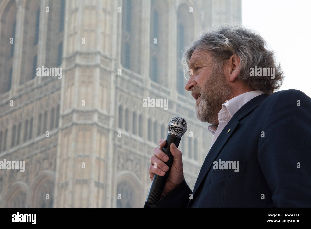 London, UK. 13th Mar, 2014. Joe Duckworth of the League Against Cruel Sports speaks as protesters gather outside Westminster while a parliamentary debate on the controversial badger cull takes place inside the house of commons. Badgers have been linked to the spread of bovine tuberculosis in cattle and experimental culls of badgers were carried out in 2013 in an attempt to stop the spread of the disease. Anti-cull protestors have claimed that the cull is inefficient, inhumane and scientifically flawed. Credit:  Patricia Phillips/Alamy Live News - Stock Image