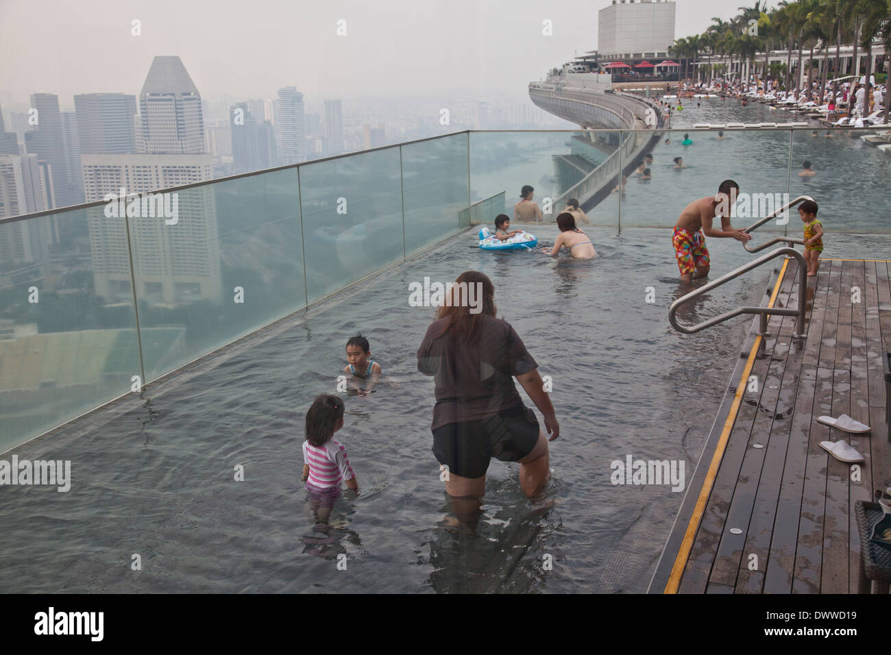 Guests Relax At The Infinity Pool At The Famous Marina Bay