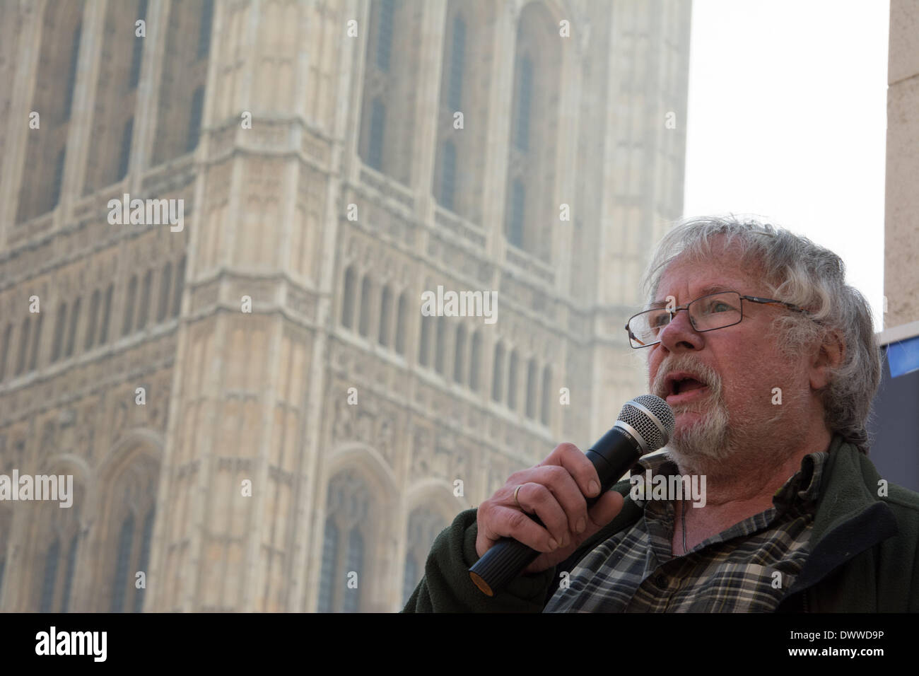London, UK. 13th Mar, 2014. TV personality and wildlife expert Bill Oddie speaks as protesters gather outside Westminster while a parliamentary debate on the controversial badger cull takes place inside the house of commons. Badgers have been linked to the spread of bovine tuberculosis in cattle and experimental culls of badgers were carried out in 2013 in an attempt to stop the spread of the disease. Anti-cull protestors have claimed that the cull is inefficient, inhumane and scientifically flawed. Credit:  Patricia Phillips/Alamy Live News - Stock Image