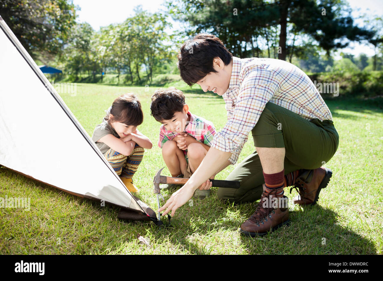 kids building camping tent stock photos kids building camping tent