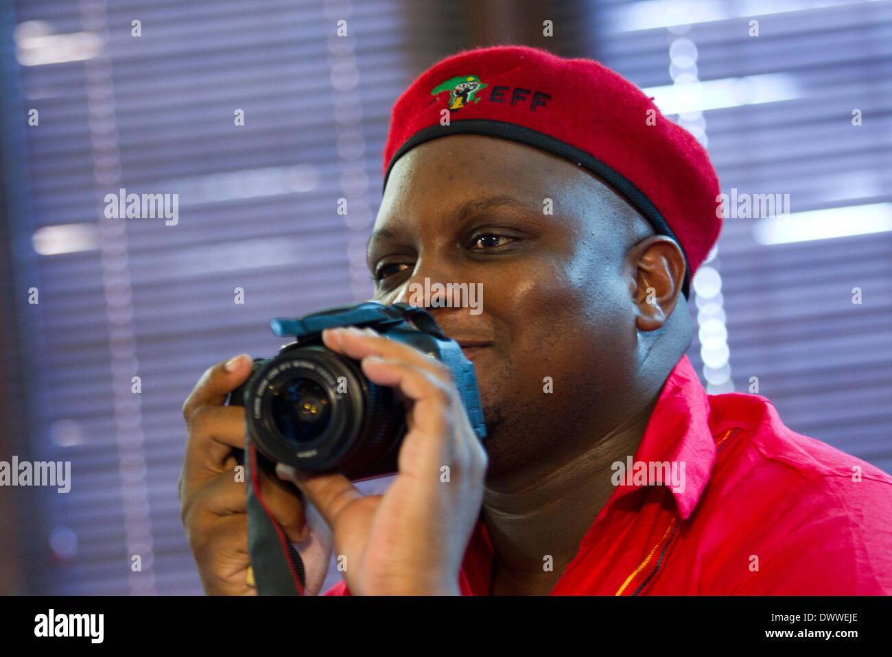 Political commissar Floyd Shivambu takes photographs as President of the Inkatha Freedom Party Mangosuthu Buthulezi and - Stock Image