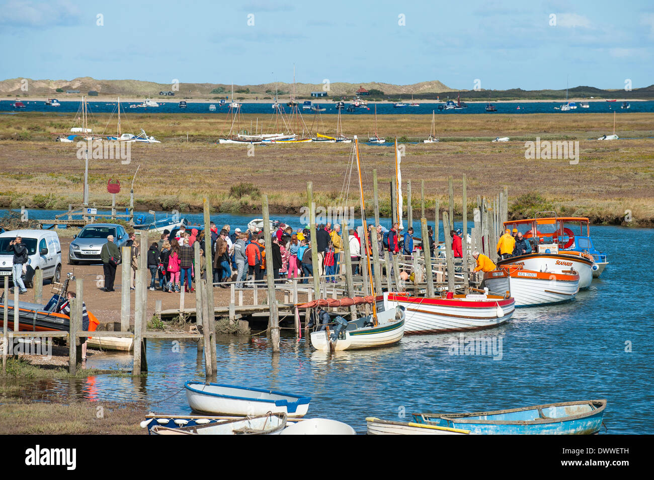 Morston Quay with tourists about to embark on to the boats to view the seals at Blakeney Point, Norfolk, England, September - Stock Image