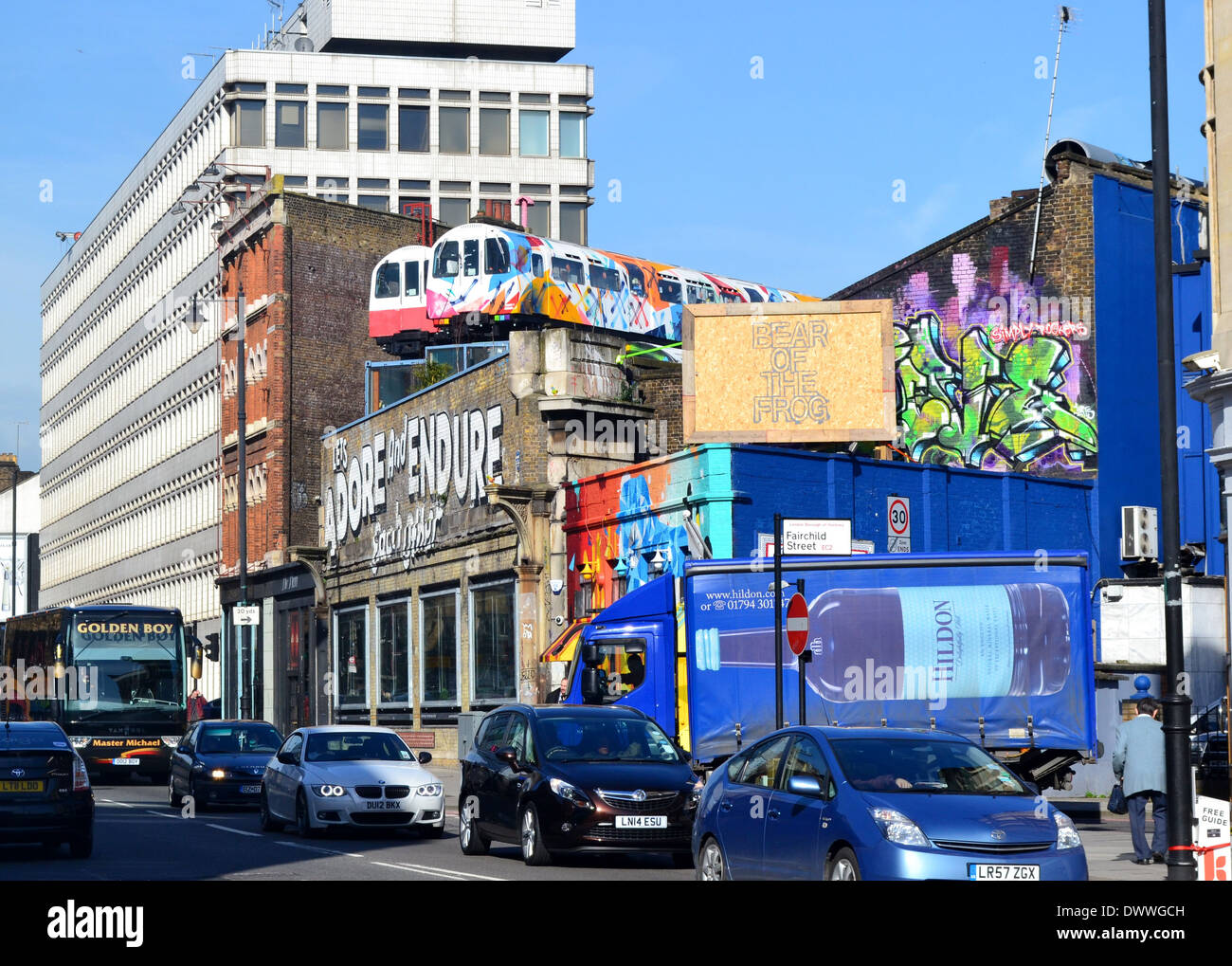 Taxi outside a building in Shoreditch, east London - Stock Image