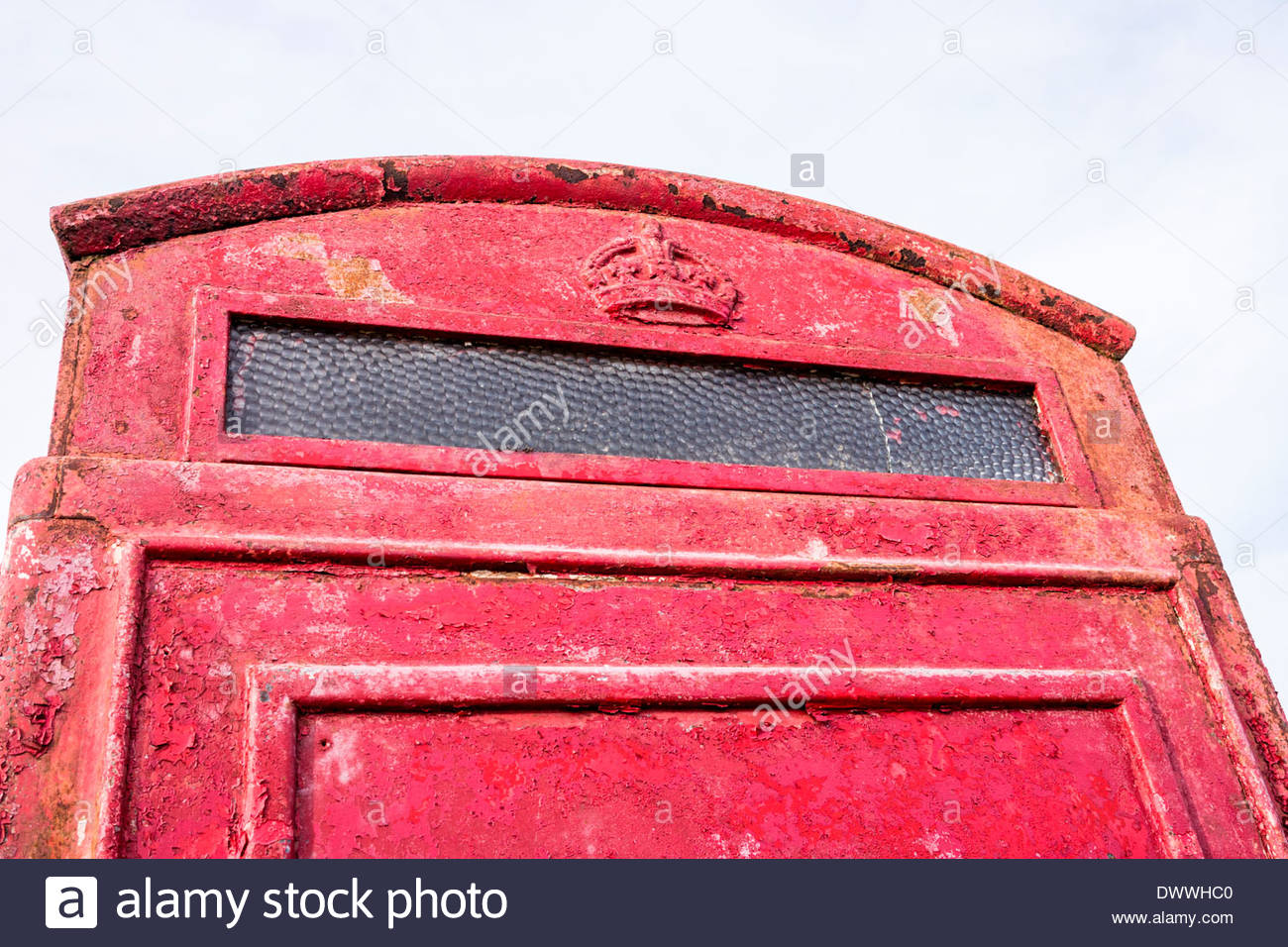 Old and weathered red telephone kiosk - Stock Image
