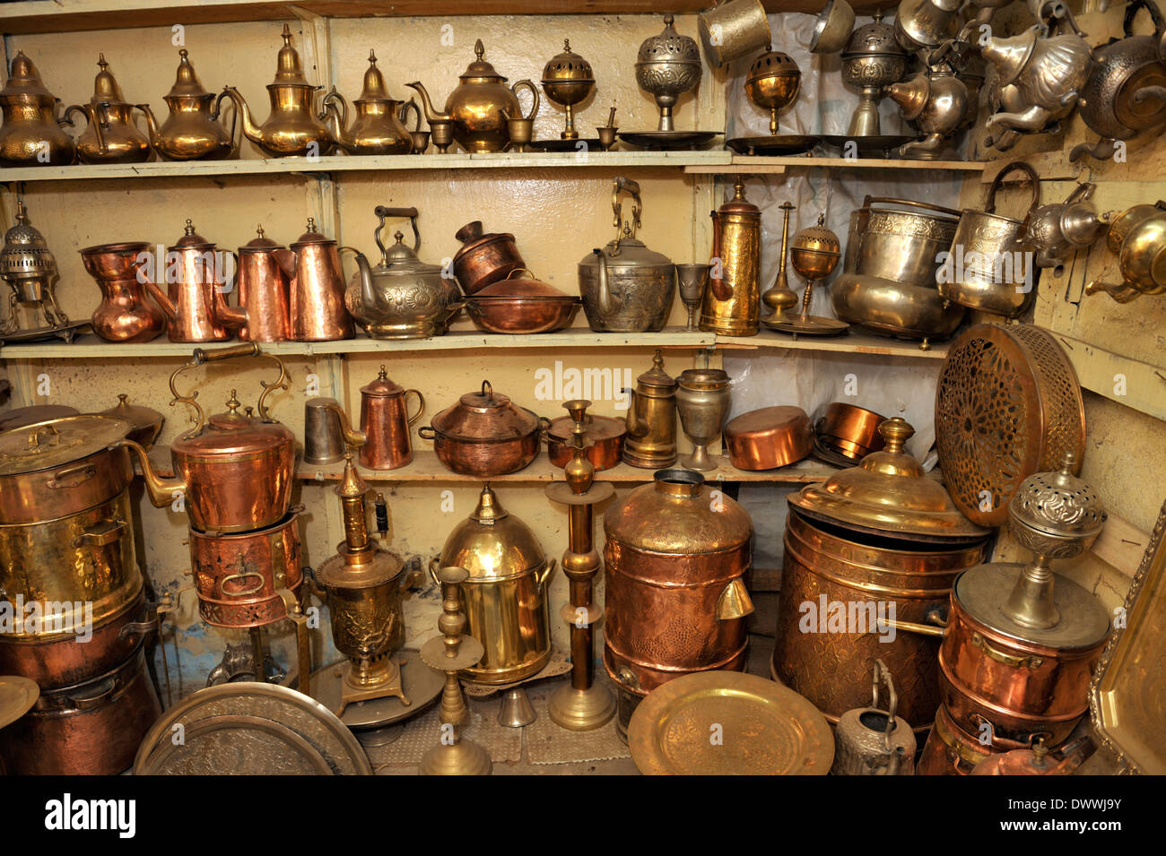 Metal work, teapots, lamps, pots, trays next to workshop in souk Marrakech, Morocco, North Africa - Stock Image