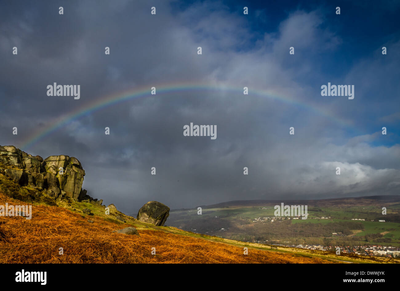 Beautiful rainbow over Ilkley taken at the famous landmark of the Cow and Calf rocks, Yorkshire countryside , UK - Stock Image