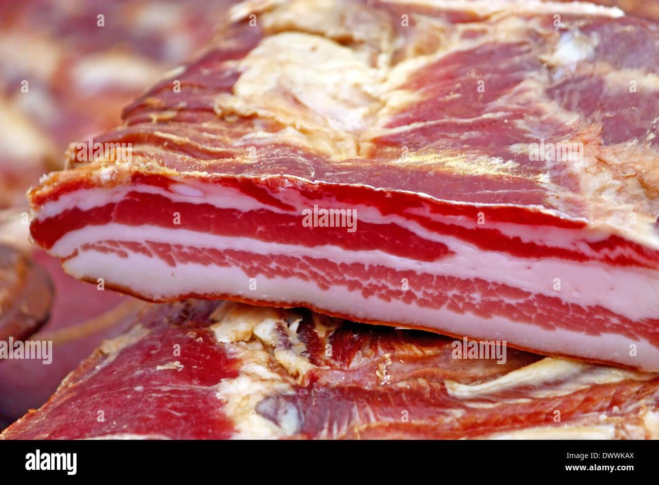 Piece of smoked bacon - Stock Image