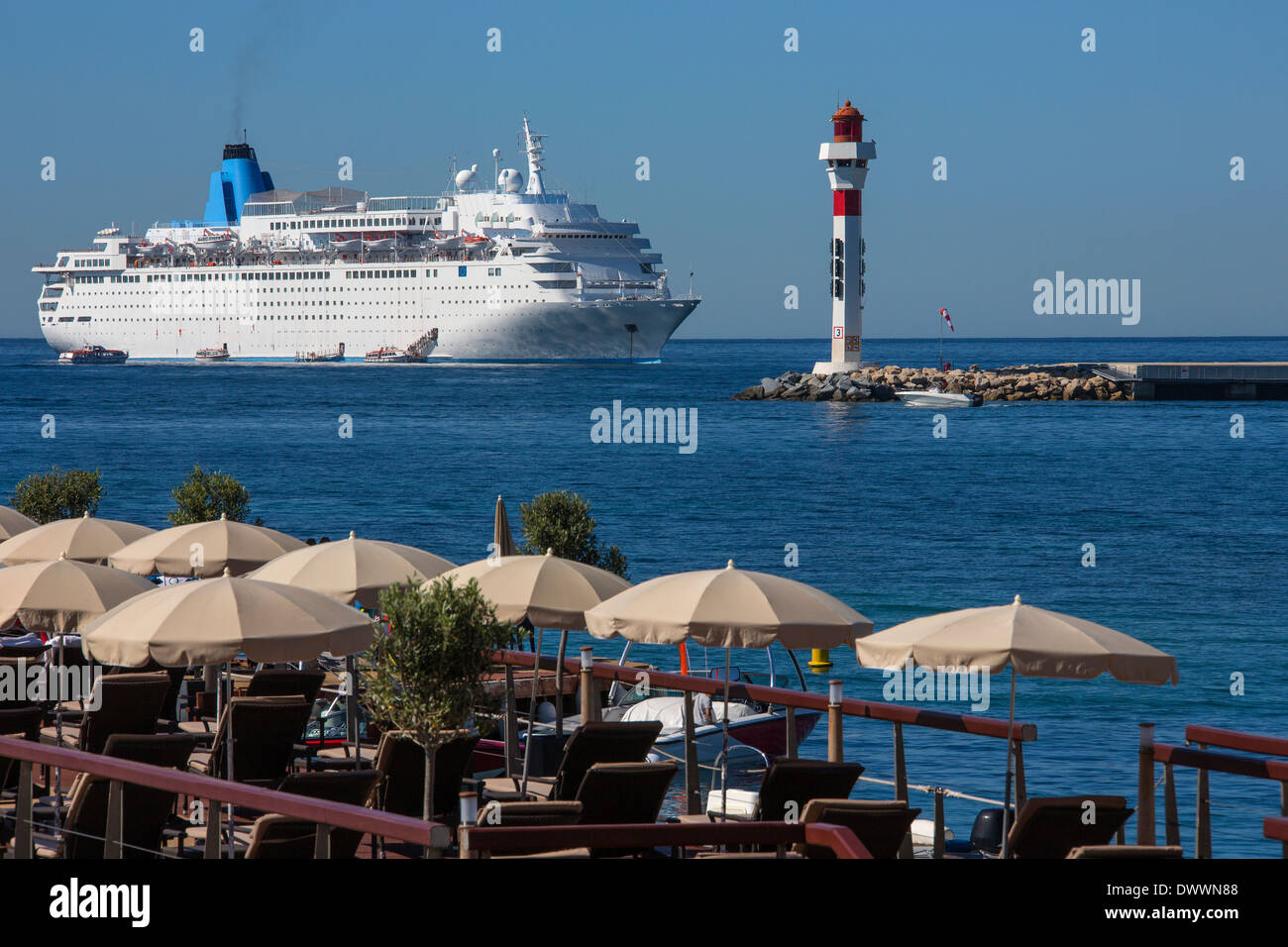 Cruise Liner moored just off the beach at Cannes on the Cote d'Azur in the South of France. - Stock Image