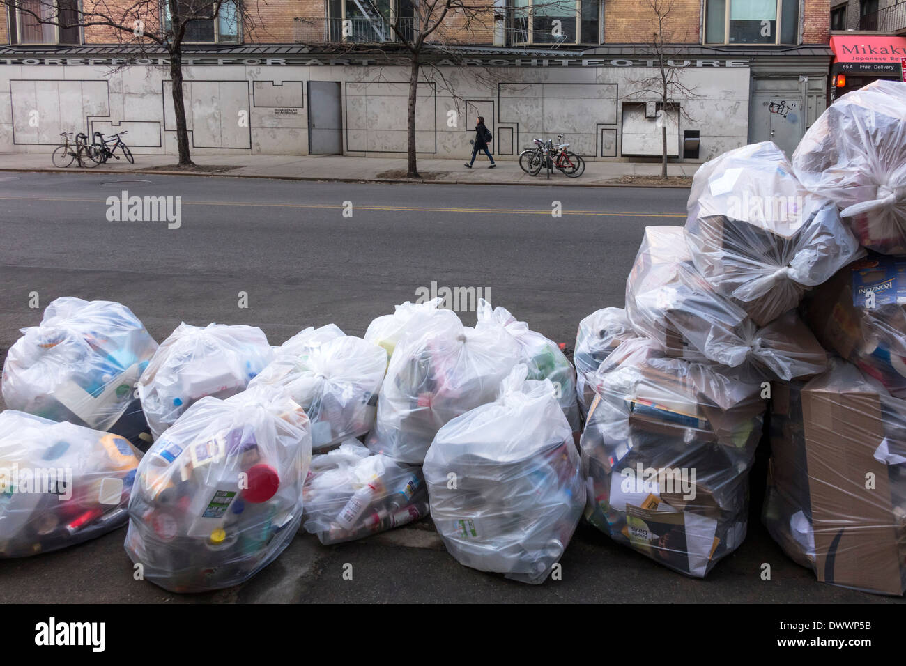 recyclable trash in clear plastic bags in New York City - Stock Image
