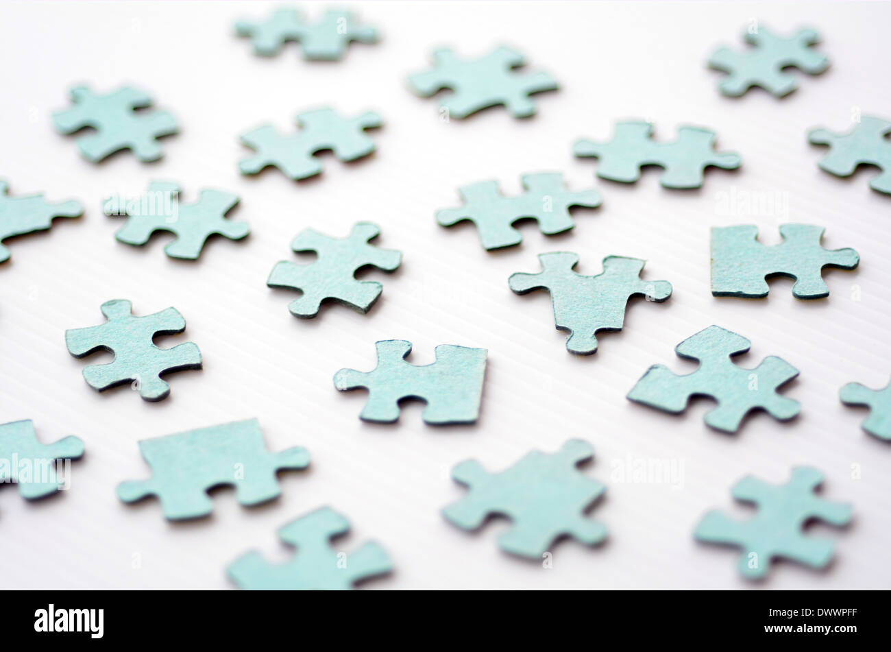 Scattered puzzle pieces toy isolated on white background. Concept photo of disharmony, change, no-order and chaos. - Stock Image