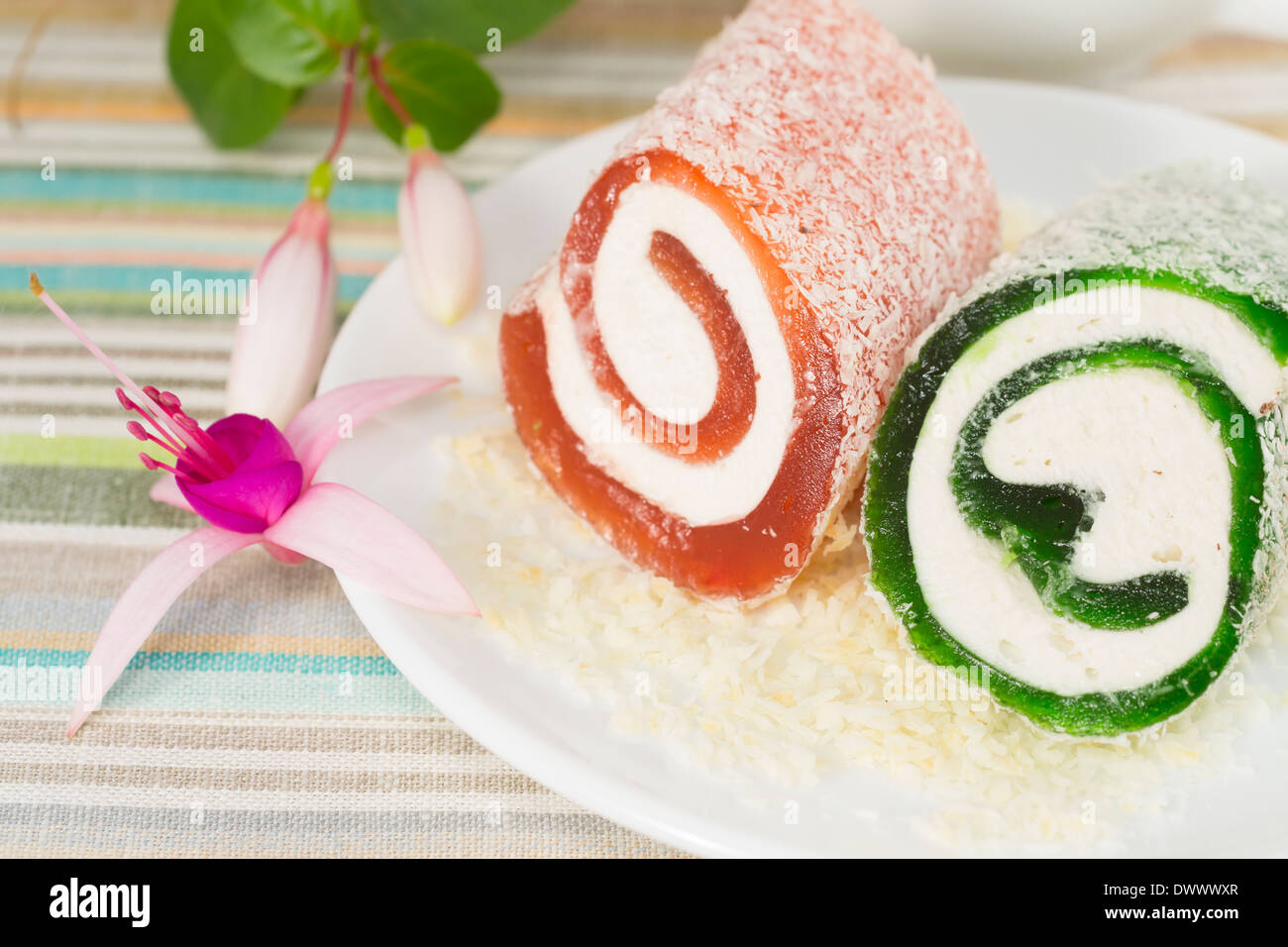 sweet dessert with flower fuchsia in a plate, Turkish Culture Stock