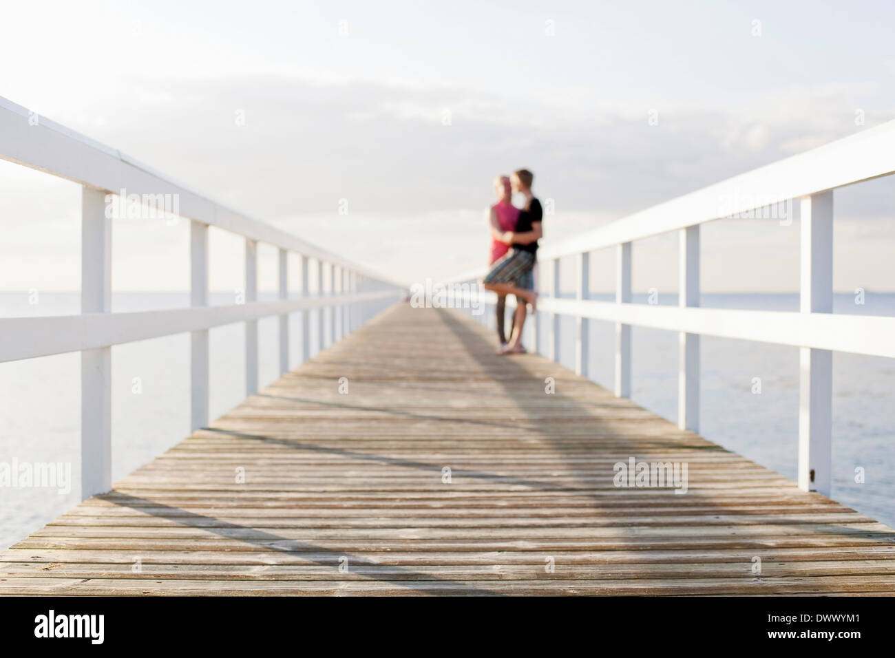 Couple standing on pier - Stock Image