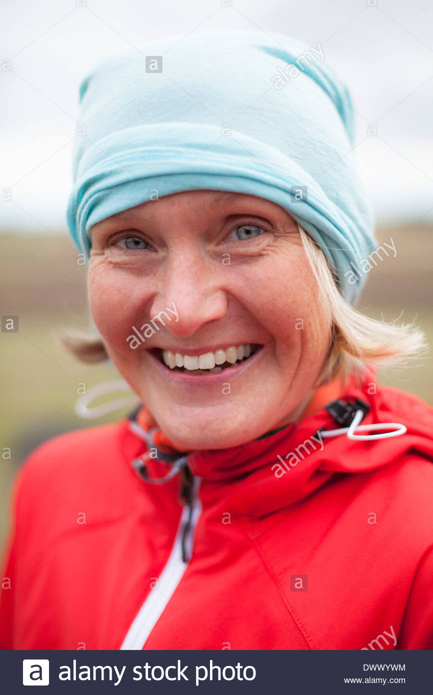 Portrait of happy mature woman wearing bandana outdoors - Stock Image