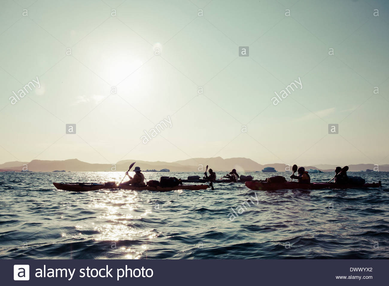 Kayakers with their kayaks on sea against sky - Stock Image