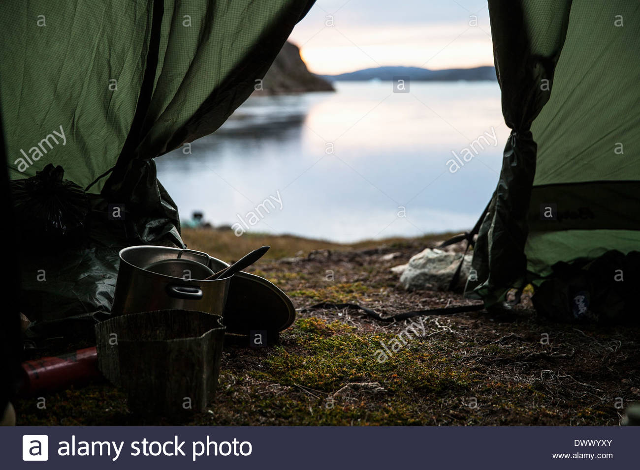 Kitchen utensil in tent at lakeshore - Stock Image