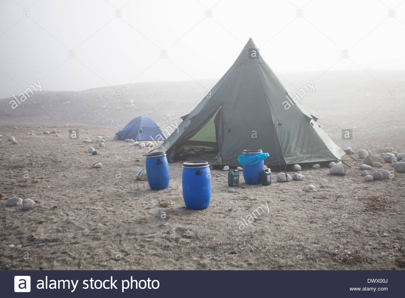 View of barrels near camping tents - Stock Image