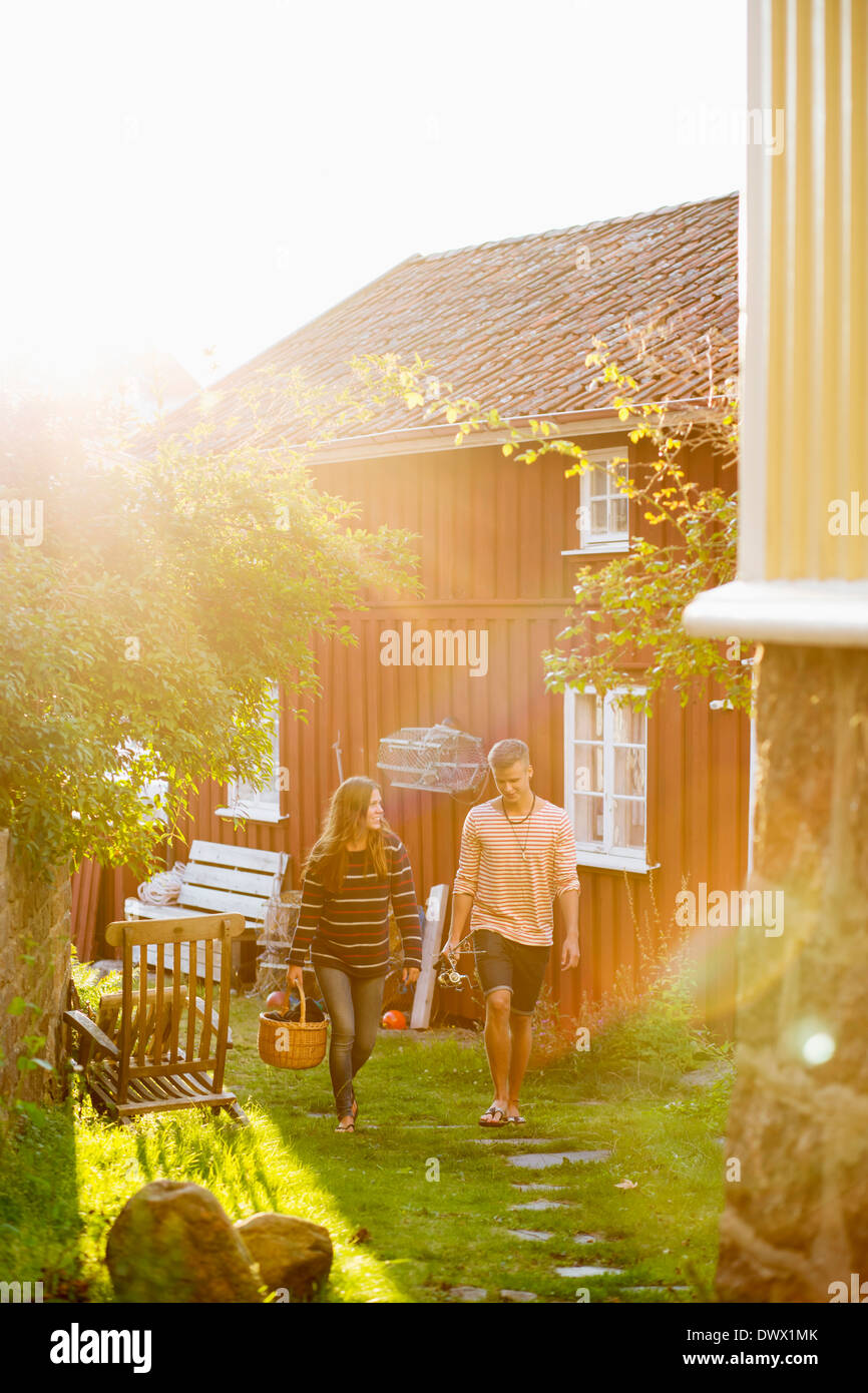 Full length couple walking together in yard Stock Photo