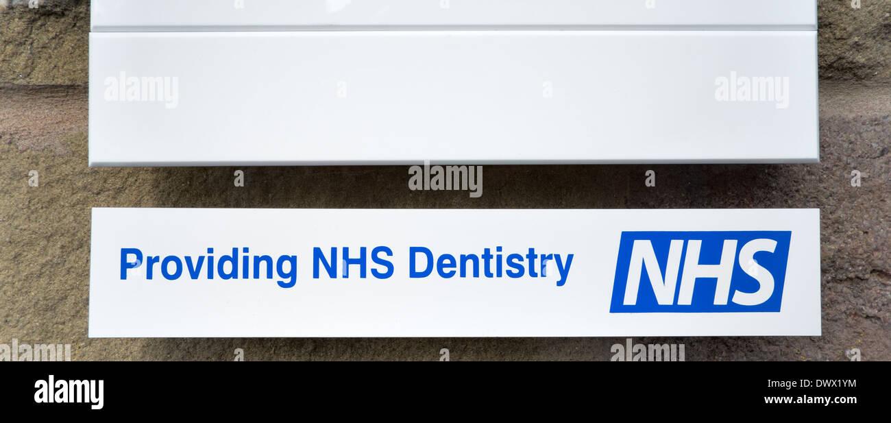 Providing NHS Dentistry dentist white sign - Stock Image