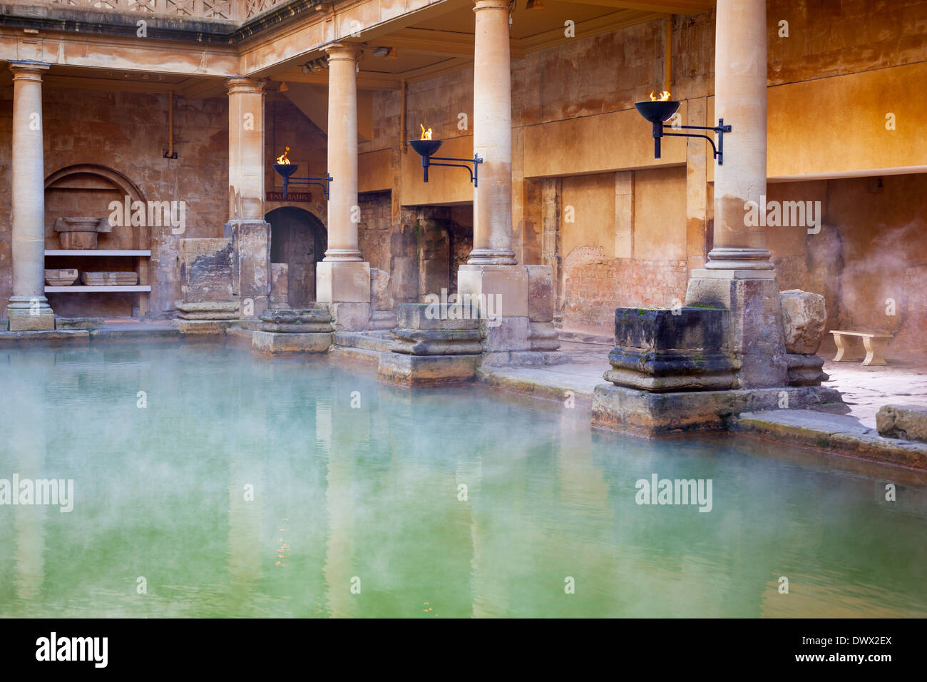Steam rising off the hot mineral water in the Great Bath, part of the Roman Baths in Bath, UK - Stock Image