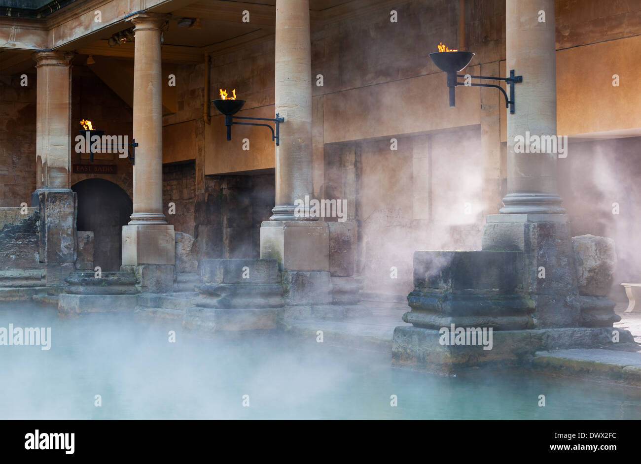 Mist rising off the hot spa water in the Great Bath, part of the Roman Baths in Bath, UK - Stock Image