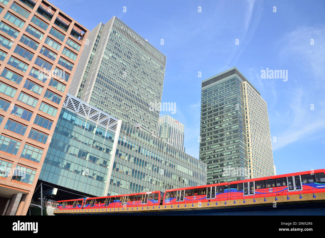 Office Blocks and the Docklands Light Railway train in Canary Wharf, Docklands, East London, England, UK - Stock Image