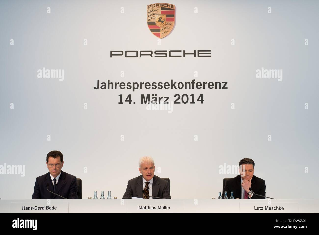 Stuttgart, Germany. 14th Mar, 2014. Hans-Gerd Bode (L-R), director of public relations, CEO of Porsche Matthias Mueller and CFO Lutz Meschke during the business results press conference at the Porsche Museum in Stuttgart, Germany, 14 March 2014. Porsche surpassed its goal to remain at the previous year's level. Photo: Sebastian Kahnert/dpa/Alamy Live News - Stock Image