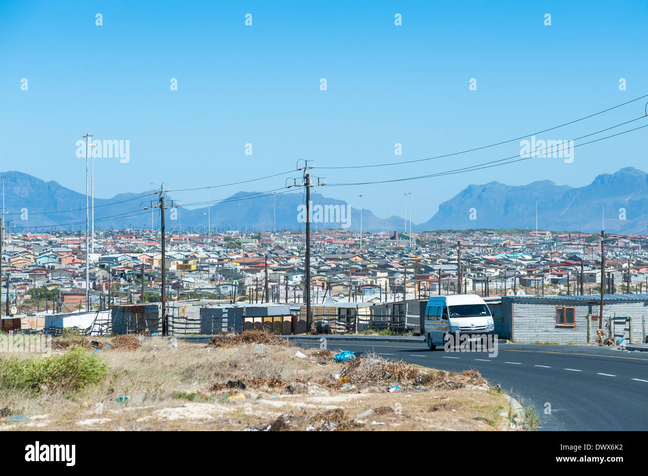Road with minibus taxi in Khayelitsha, Cape Town, Western Cape, South Africa - Stock Image