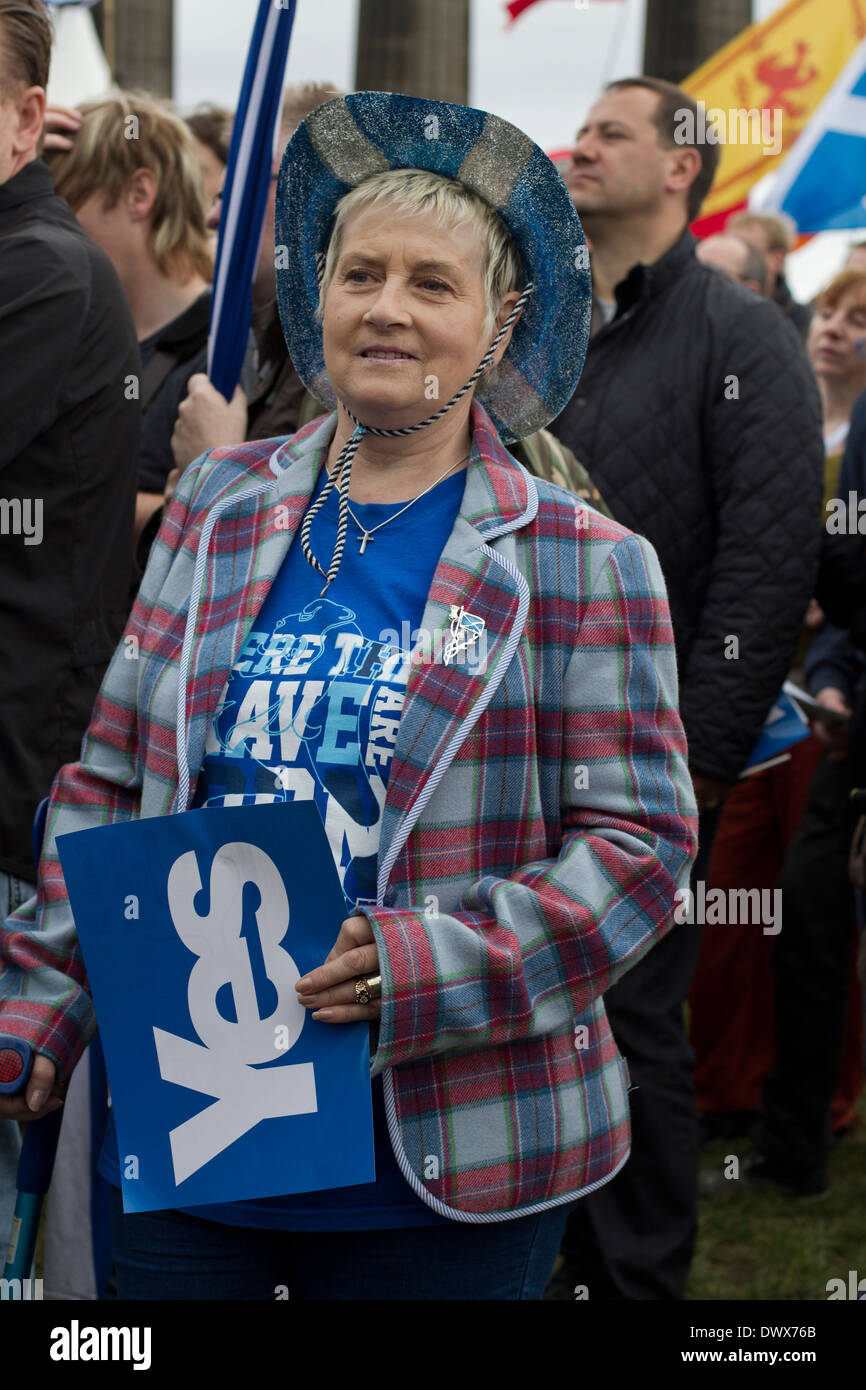 A woman in a tartan jacket listening to speeches during a pro-Independence rally in Edinburgh in 2013. - Stock Image