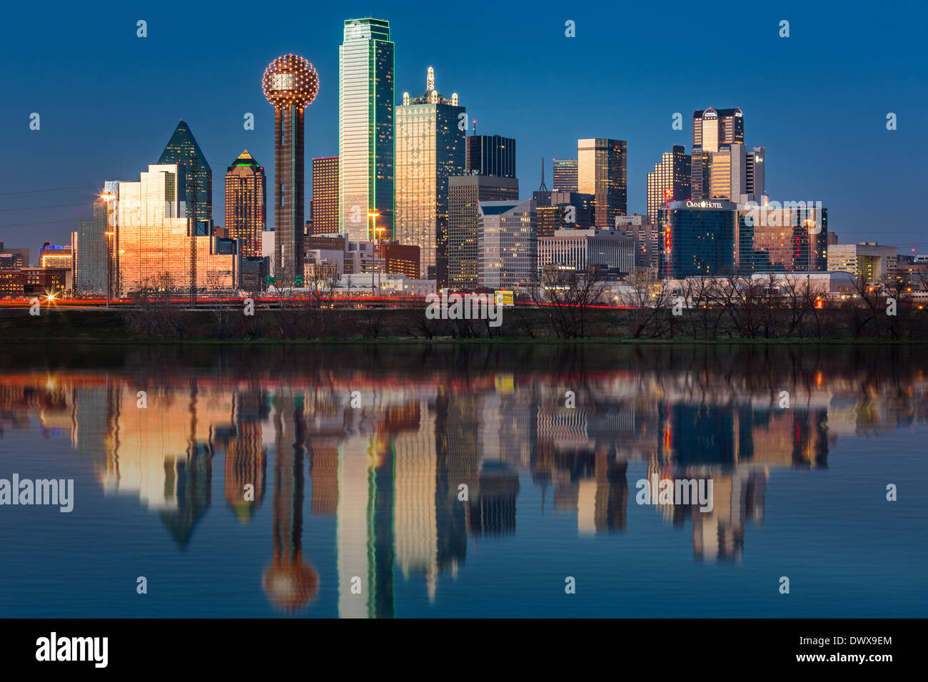 Dallas skyline reflected in Trinity River at sunset - Stock Image