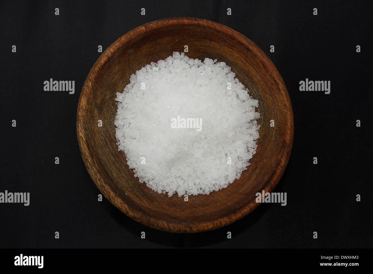 wooden bowl of Epsom Salts - Stock Image