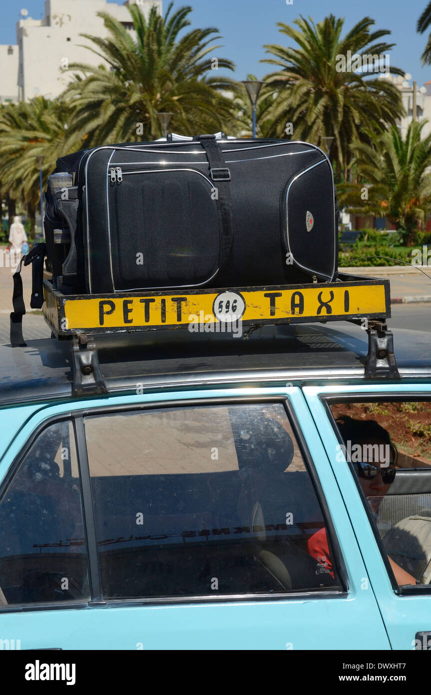 Petit taxicab roof-rack with luggage. Morocco Stock Photo