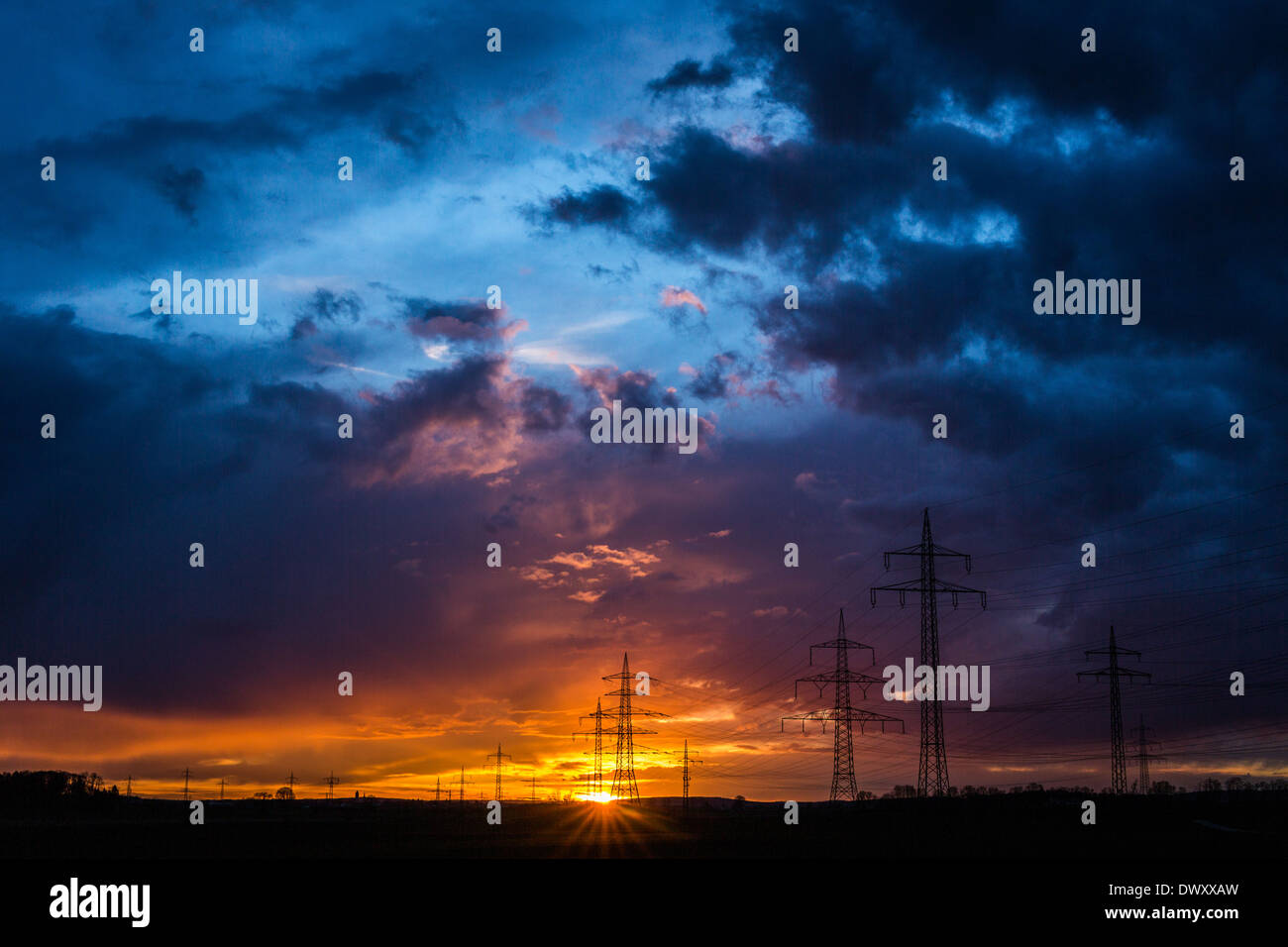 Sunset with pylons - Stock Image