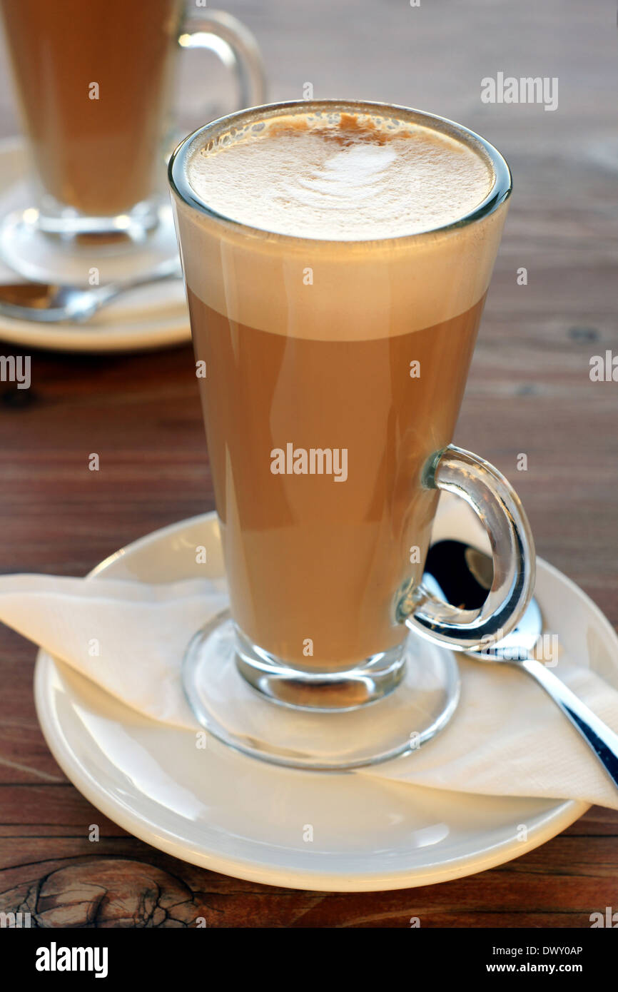 Latte Coffee Or Caffe Latte In Tall Latte Glasses With Table Settings Stock Photo Alamy