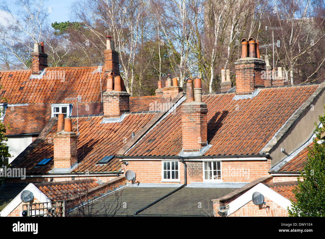Chimney pots and pan tiled roofs in Woodbridge, Suffolk, England - Stock Image