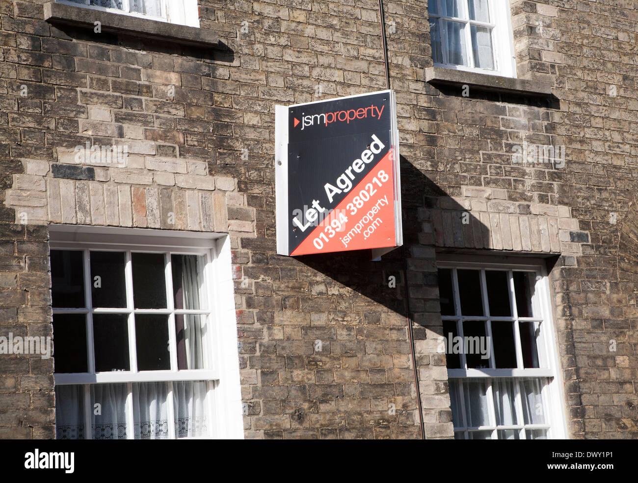 JSM Property Let Agreed estate agents sign on building, Woodbridge, Suffolk, England - Stock Image