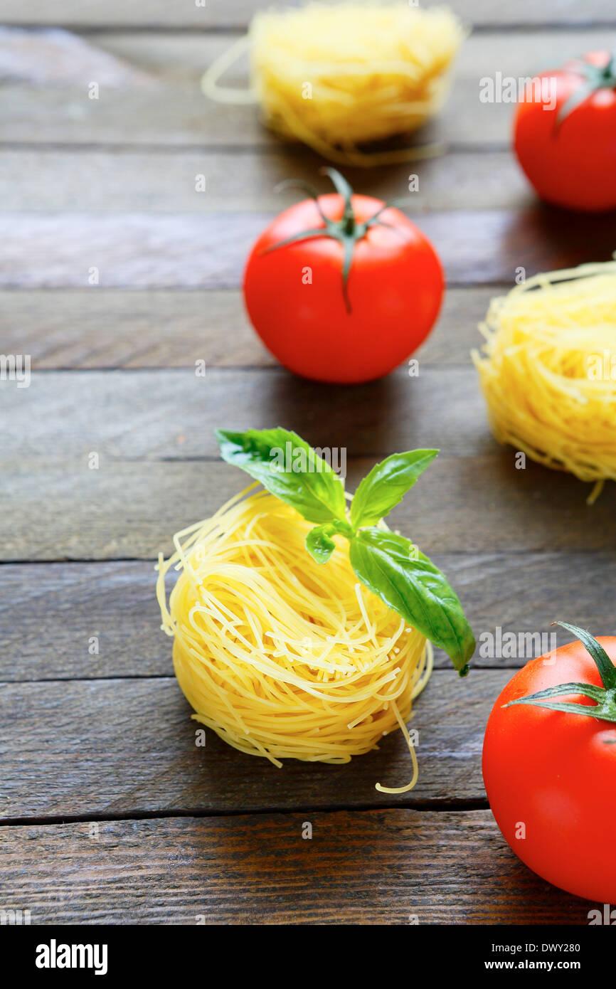 pasta and tomatoes, food closeup - Stock Image