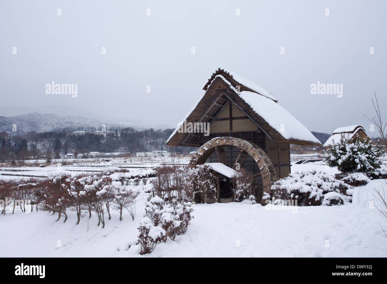 Water wheel house in winter - Stock Image