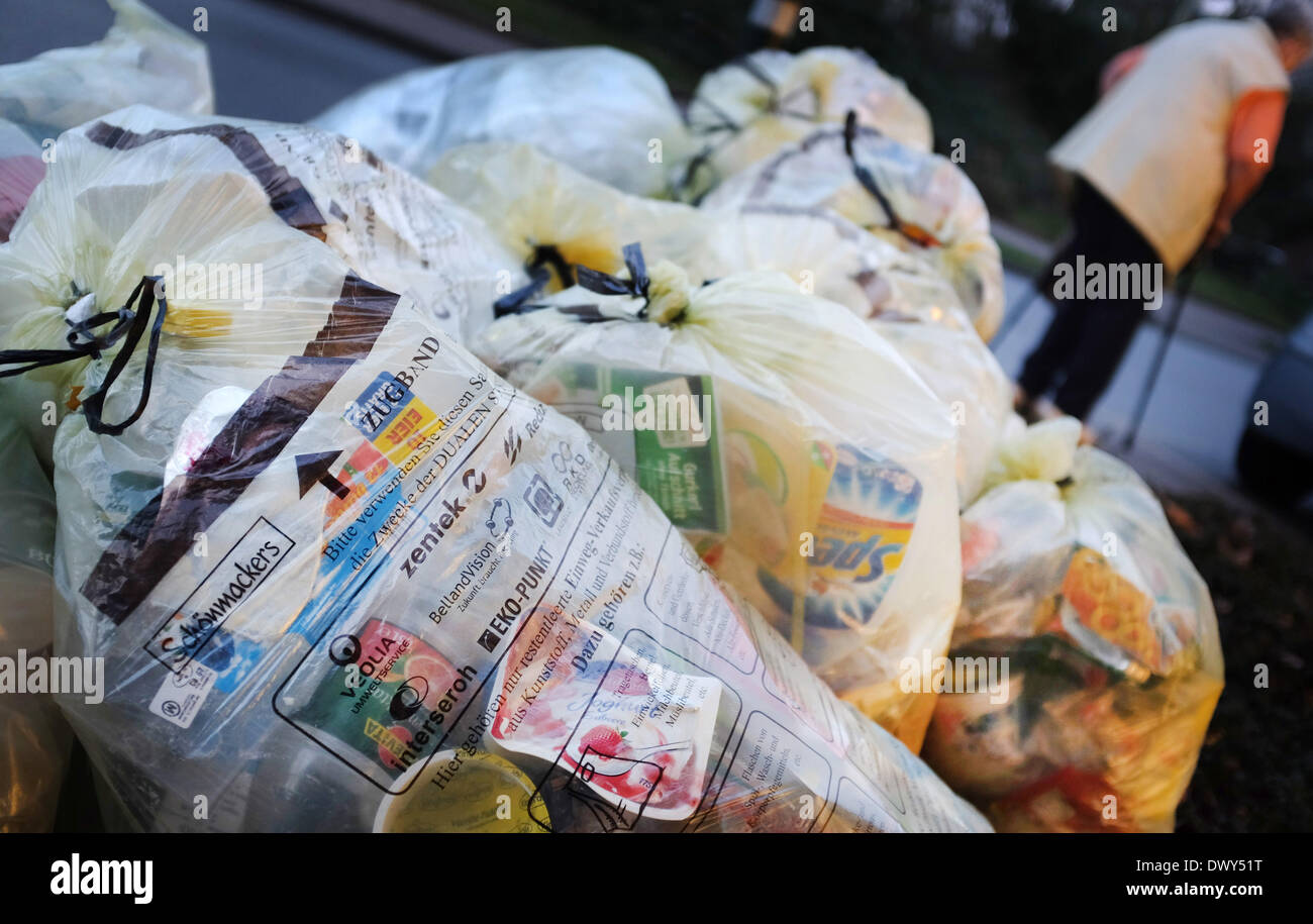 Hamminkeln, Germany. 11th Mar, 2014. Yellow rubbish sacks lie on the roadside to be picked up in Hamminkeln, Germany, 11 March 2014. Lightweight packaging waste is collected in the yellow waste bags. Photo: Martin Gerten/dpa/Alamy Live News - Stock Image