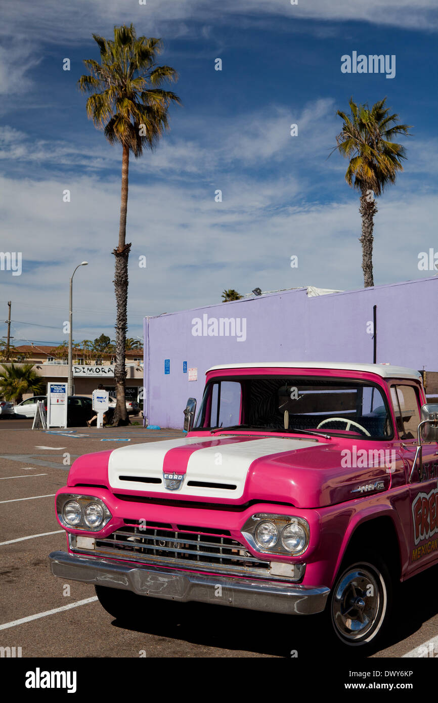 A bright pink Ford F100 from the sixties is being used to promote the business of Fred's Mexican Cafe. 15 February 2013. - Stock Image