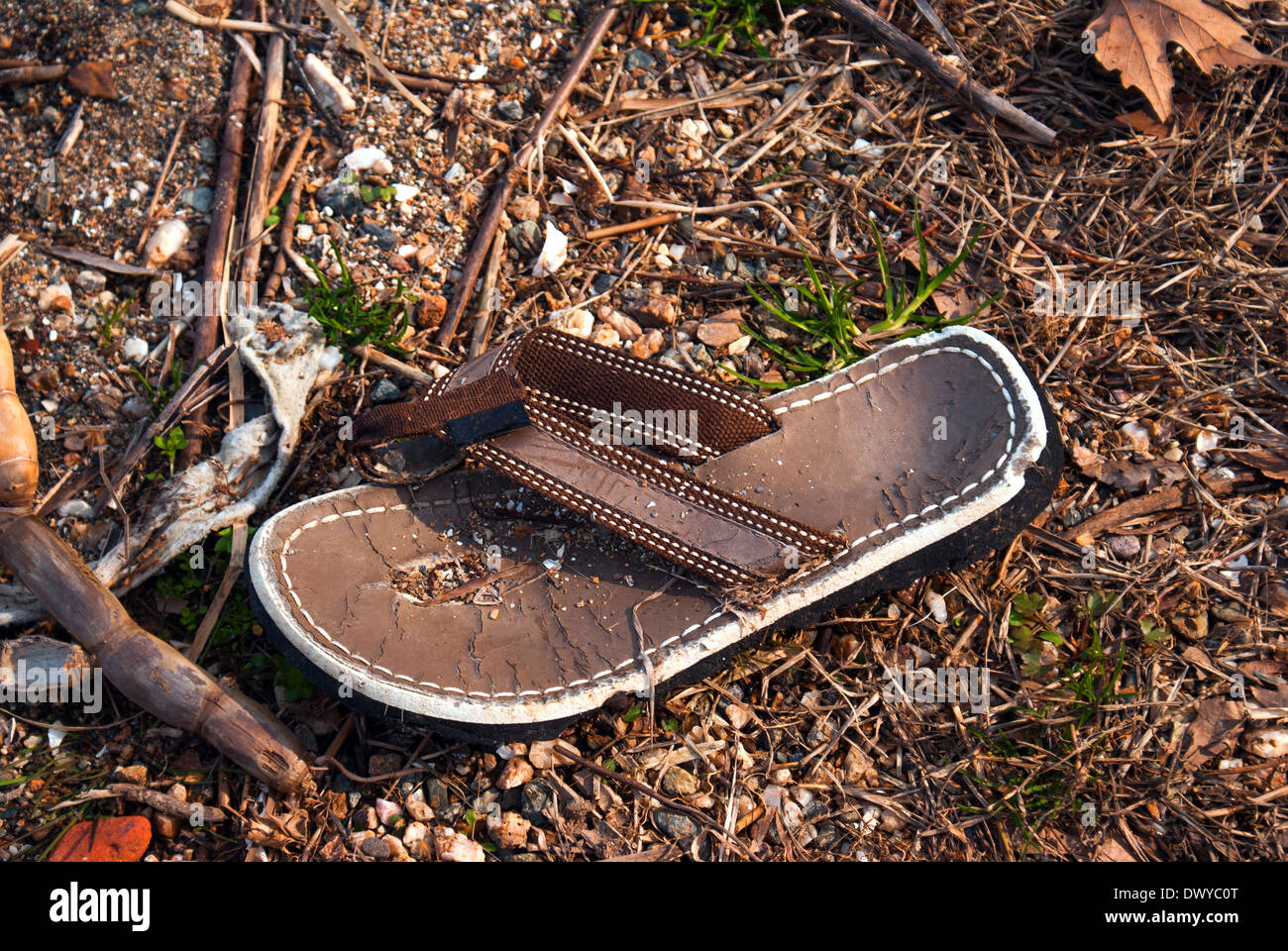 Lost old beach shoes - Stock Image