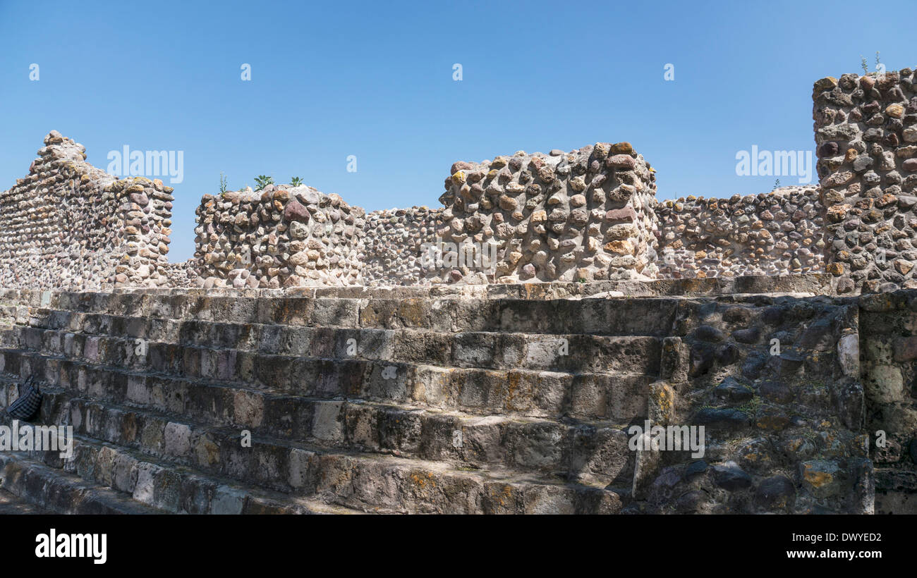 dappled sun on beautiful old stone of Council Chamber facade evokes serenity of  earlier time in ruins of ancient city of Yagul - Stock Image