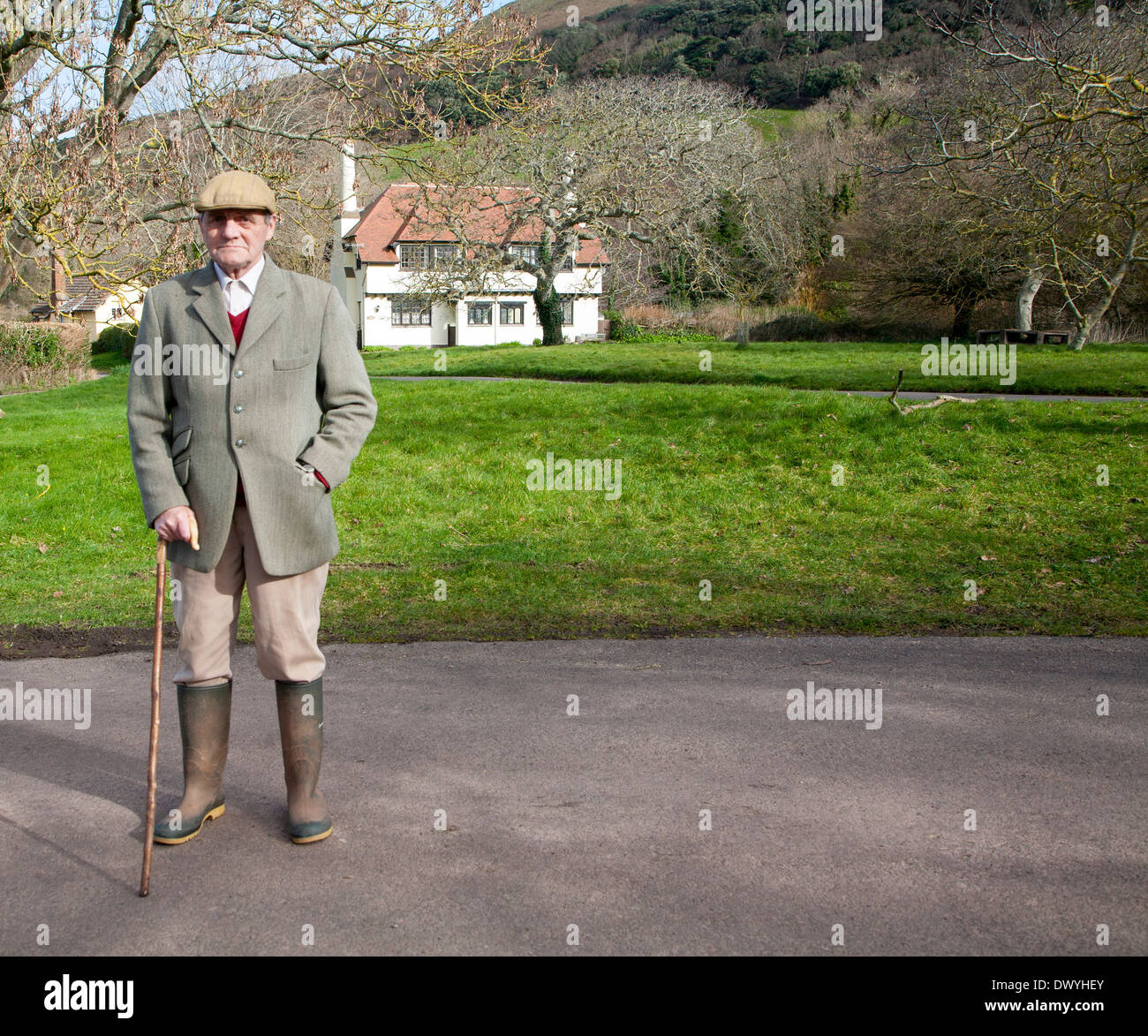 Smartly dressed gentleman out for his morning walk in Bossington, Exmoor national park, Somerset, England - Stock Image
