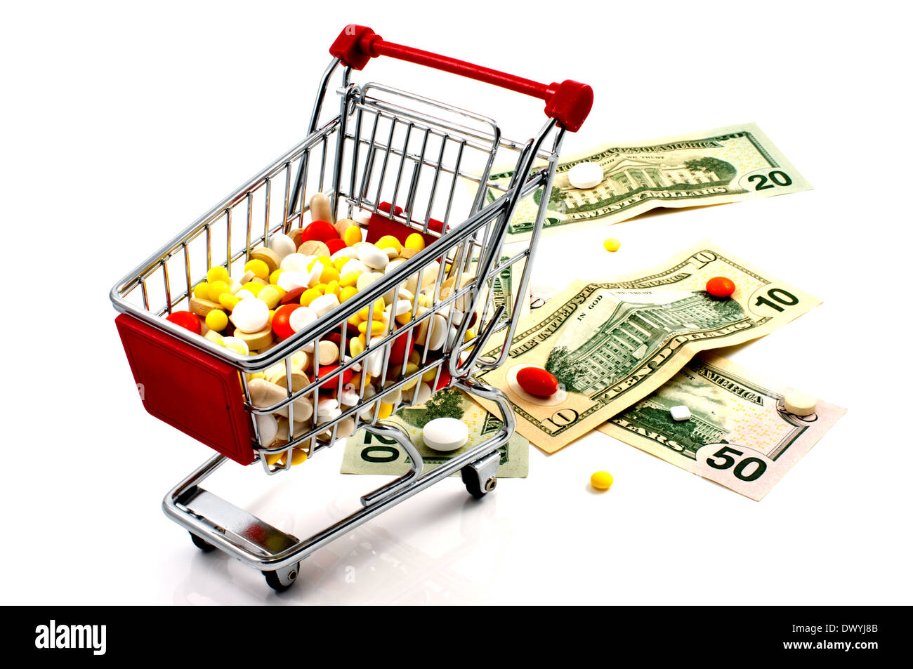 Drugs in the shopping cart on a white background. Money and pills nearby. Stock Photo