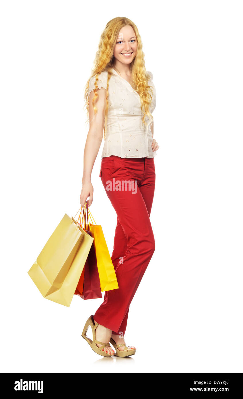 happy girl with shopping bags, isolated on white - Stock Image