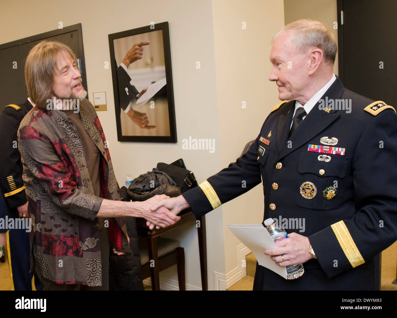 US Joint Chiefs Chairman Gen. Martin Dempsey with Kermit the Frog puppeteer, Steve Whitmire, backstage prior to a movie screening of the new Muppets movie, 'Muppets Most Wanted', for military families at the White House March 12, 2014 in Washington, DC. - Stock Image