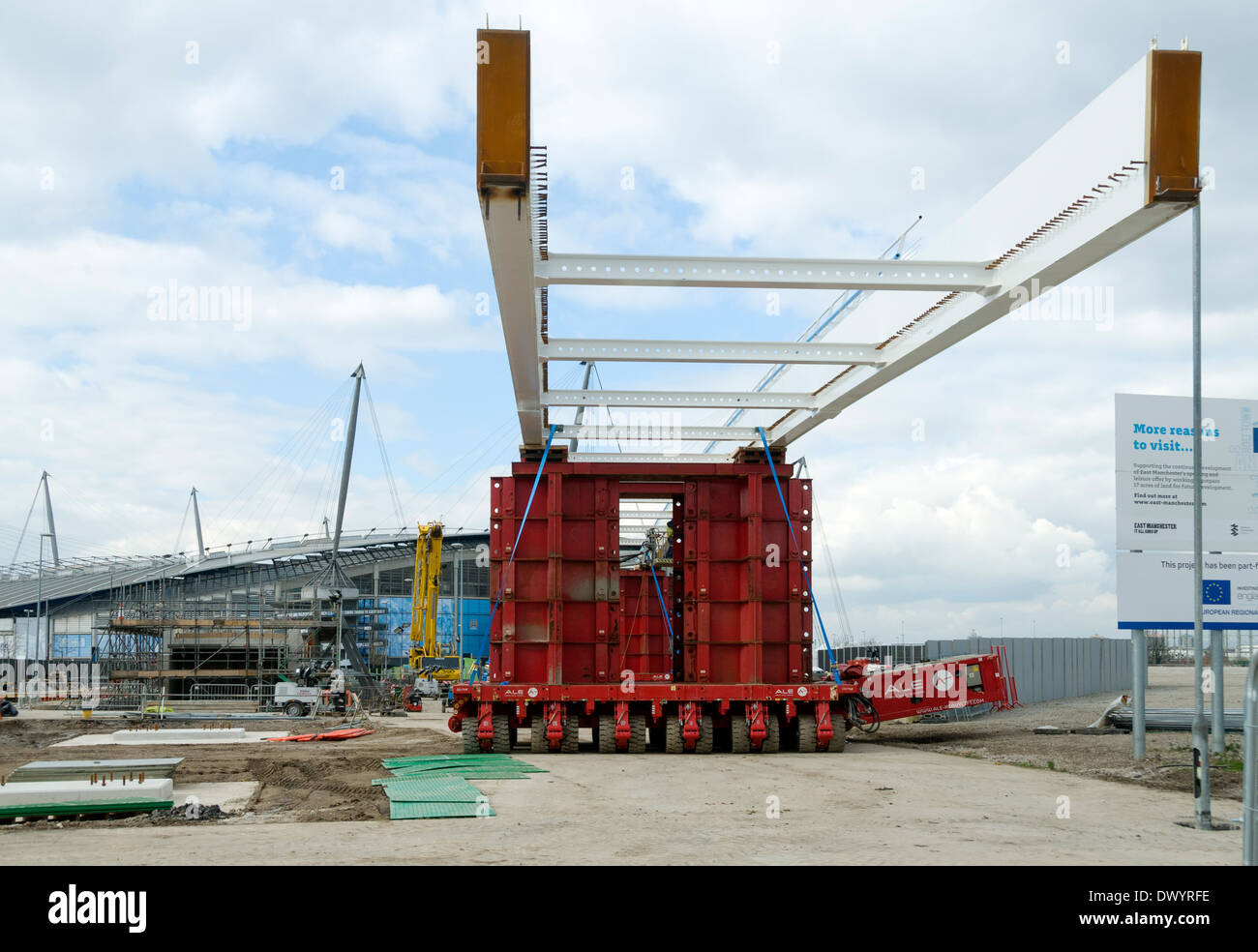 Etihad Campus footbridge about to be moved into position supported on multi-wheeled transporters, Manchester, England, UK - Stock Image