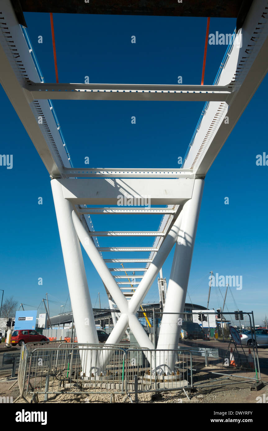 Etihad Campus footbridge under construction across a major road junction, Clayton, Manchester, England, UK - Stock Image
