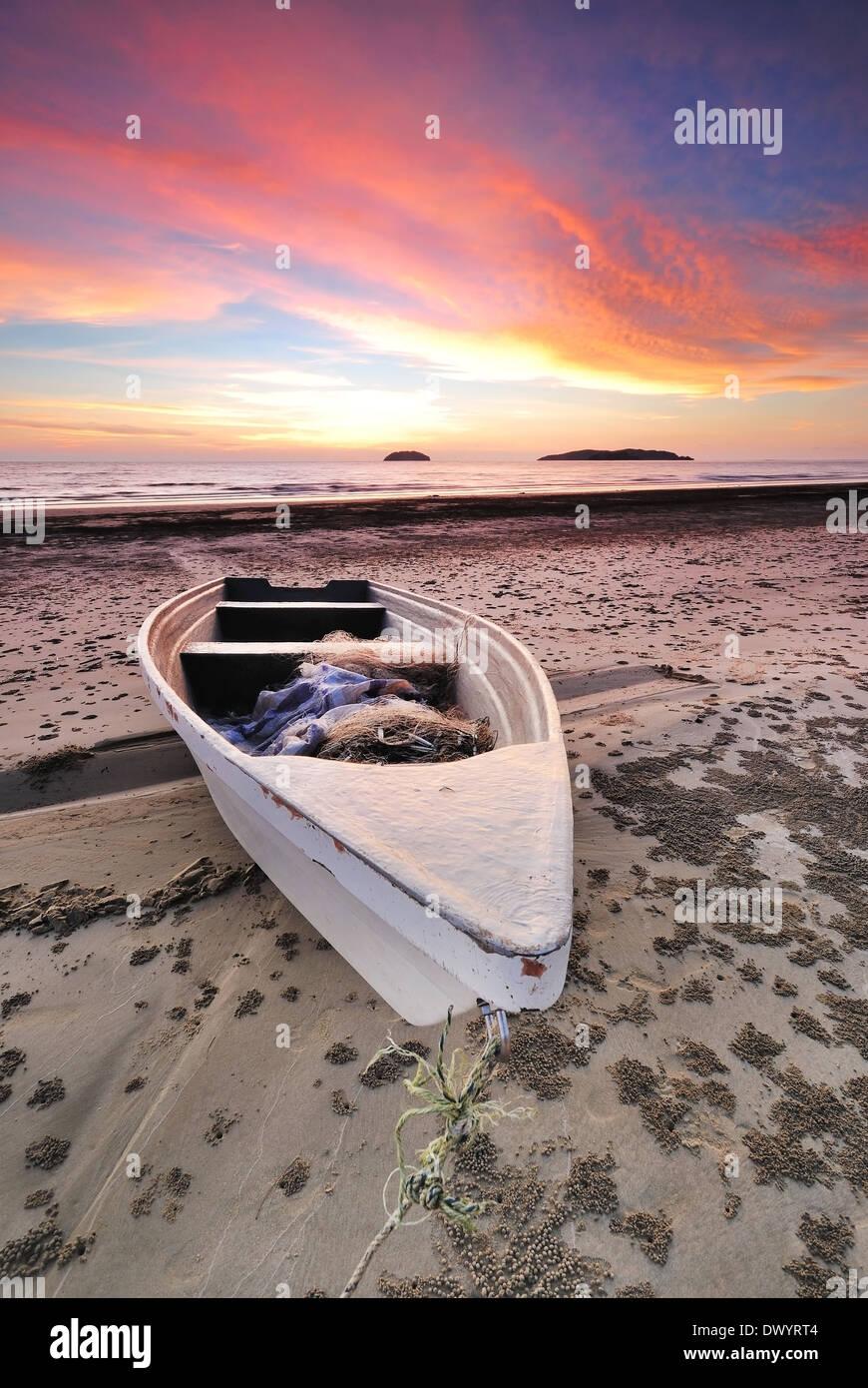 Boat and beach sunset in Tanjung Aru beach, kota kinabalu, sabah, borneo, malaysia - Stock Image